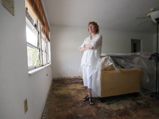 Anita Dennis, a resident of The Villas in south Fort Myers, stands in her gutted living room Monday, Sept. 18. Her home was flooded in a late August storm and then was flooded again in Hurricane Irma. She has no flood insurance and is hoping FEMA will help her.