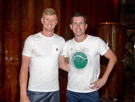 British tennis player Kyle Edmund, left, poses for a photo with former British player Tim Henman in a hotel in Melbourne, Australia, Wednesday, Jan. 24, 2018. Edmund will play Croatia's Marin Cilic in a semifinal at the Australian Open tennis championships here on Thursday Jan 25. (Fiona Hamilton/Tennis Australia via AP)