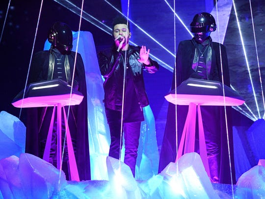 The Weekend (center) and Daft Punk