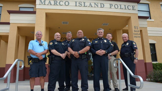 Police officers Bob Marvin, from left, Capt. Dave Baer, Frank Linkenberg, Sgt. Hector Diaz, Chief Al Schettino, Sgt. Brian Hood, and Bill Miller.