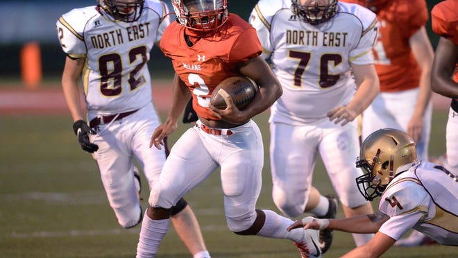 General McLane High School senior Jaxon Scrutchins runs against North East in the first half at Linden Field on Sept. 12, 2020, in Washington Township.