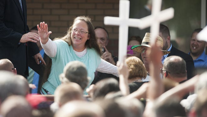 Rowan County Clerk of Courts Kim Davis waves to a crowd of her supporters at a rally in front of the Carter County Detention Center in Grayson, Ky., on Sept. 8, 2015. Davis was ordered to jail last week for contempt of court after refusing a court order to issue marriage licenses to same-sex couples.