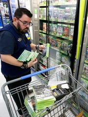 Scott Low stocks video games Tuesday in advance of