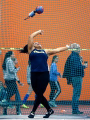 Webster Thomas thrower Monique Hardy breaking the Section V hammer throw during the indoor sectionals last winter at Rochester Institute of Technology.