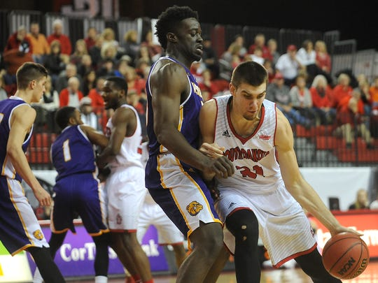 USD's #31 Dan Jech drives to the basket against WIU's