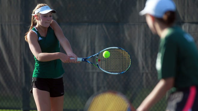 West High's Abby Jans returns her shot during her doubles match with Megan Jans against City High's Innes Hicsasmaz and Eve Small at the Hawkeye Tennis and Recreation Complex on Tuesday, April 28, 2015.