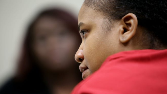 Mitchelle Blair, who is accused in the deaths of two of her children, is seated before Wayne County Circuit Judge Edward Joseph  during a custody trial Thursday, June 4, 2015 in Detroit.