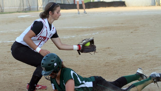 City High's Sam Blowers tries to tag West High's Taylor Libby at third base during their game at City High on Saturday, July 13, 2013.