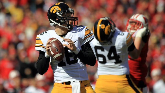 Iowa quarterback C.J. Beathard looks for an open receiver during the Hawkeyes' game against Wisconsin at Camp Randall in Madison on Saturday, Oct. 3, 2015.