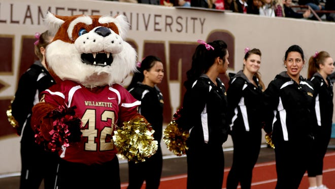"""Willamette's mascot, """"Blitz,"""" cheers on the Bearcats against Linfield in 2015. Willamette's season this year is put on hold because of the coronavirus pandemic."""