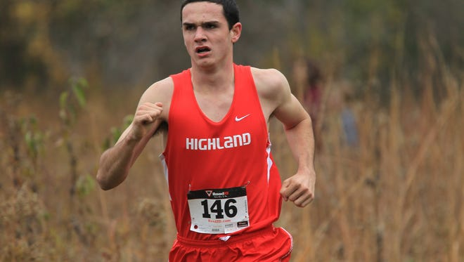 Highland's Keiffer Sexton runs down course during the Class 1A and 3A district meet in Solon on Thursday, Oct. 23, 2014.