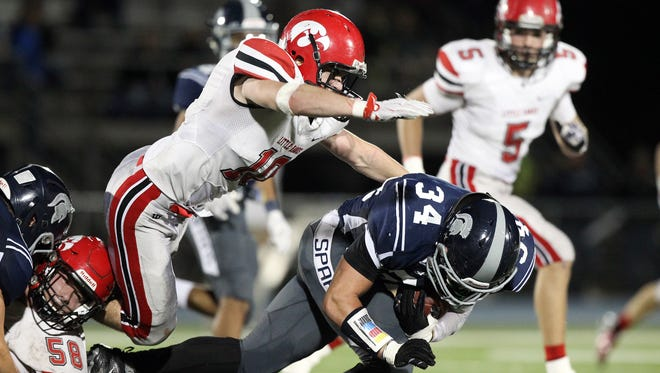 City High's Kyle Swenning chases down Pleasant Valley's David Carr during their game at Pleasant Valley on Monday, Nov. 2, 2015.