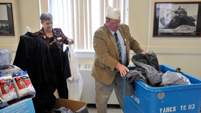 Jim Kellog and Carol Kottom, of the American Legion and American Legion Auxiliary, load items donated to St. Cloud VA Health Care System by American Legion Post 621.