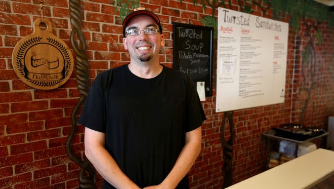 Michael Moore, the owner of Twisted Sandwiches, now open in the Reed Opera House. Photographed in Salem on Wednesday, April 6, 2016.