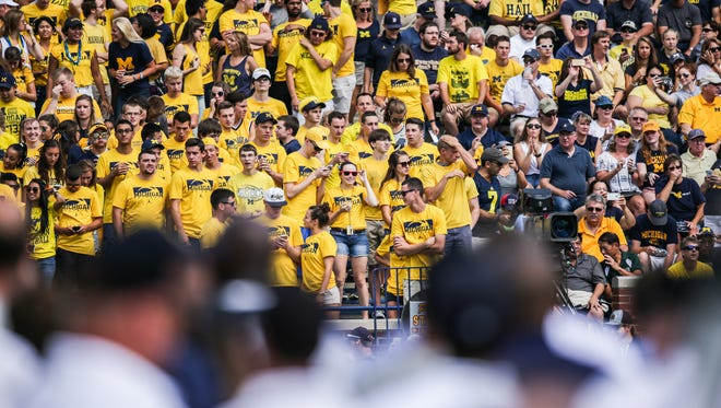 Michigan Wolverines fans cheer as their team enters the field before the opener against Hawaii at Michigan Stadium in Ann Arbor, Michigan, on Saturday, September 3, 2016.