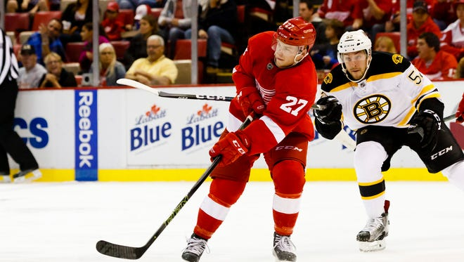 Joe Hicketts skates with the puck in a Red Wings exhibition game Sept. 30, 2016 at Joe Louis Arena.