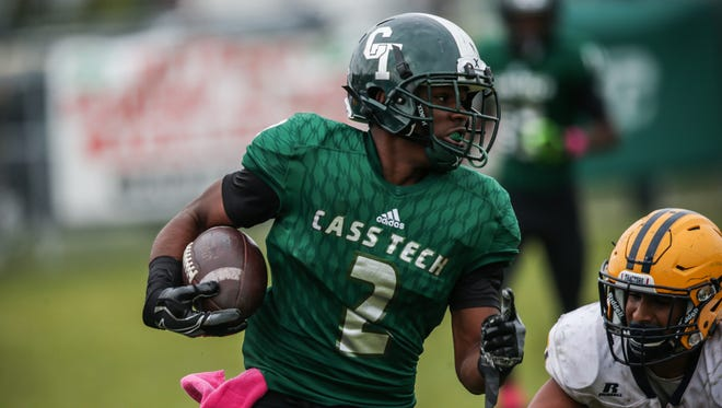 Cass Tech's Donovan Johnson runs the ball to score a touchdown during a 35-7 win over Dearborn Fordson in Detroit.