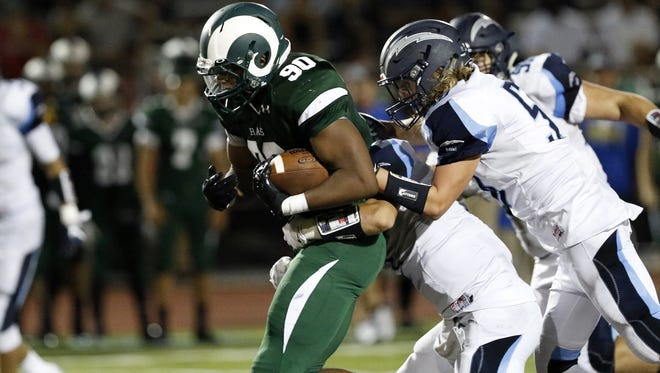 Micah Parsons of Central Dauphin, who later transferred to Harrisburg, is shown in action this fall.
