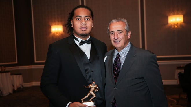 Phil Paea receives The Free Press 2016 All-State Dream Football Team Award from Tony Versaci, President, National Football Foundation, State of Michigan Chapter, at Dearborn Inn on Wednesday, February 15, 2017 in Dearborn, MI.