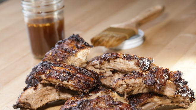 Baby back ribs with Carolina-style sauce recipe prepared by Detroit Free Press reporter Sue Selasky at the Great Lakes Culinary Center in Southfield.