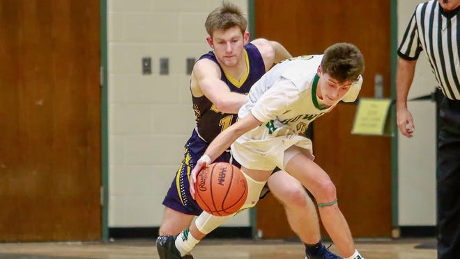Howell's Kip French steals the basketball in front of DeWitt's Mason Laube during the Highlanders' 52-50 victory on Wednesday, Jan. 3, 2018..