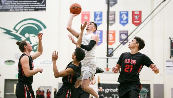 West Salem's Kyle Greeley (5) goes up for a basket