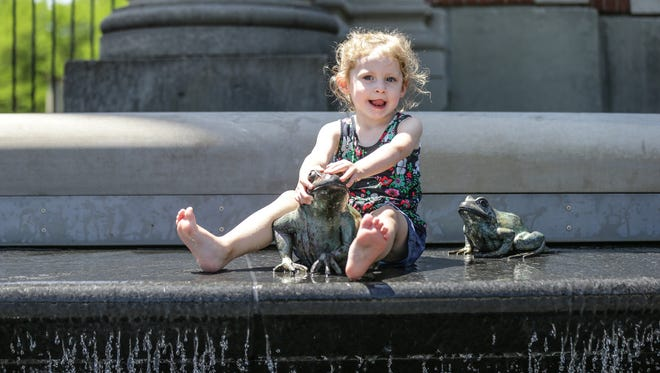 Jeliet Wagoner keeps cool in the fountain at Holliday Park in Indianapolis on Wednesday, May 23, 2018.