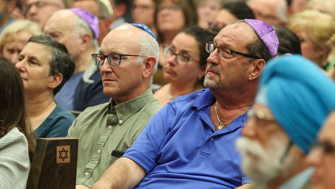 Supporters and members of the Central Indiana Jewish community listen as local leaders speak up for community solidarity at a gathering for Congregation Shaarey Tefilla in Carmel, Ind., Monday, July 30, 2018,. The event was held after anti-Semitic graffiti was discovered spray-painted on the synagogue property over the weekend.