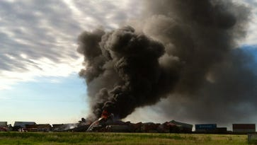 In this photo provided by Billy B. Brown, two freight trains are on fire Tuesday, June 28, 2016, after they collided and derailed near Panhandle, Texas.
