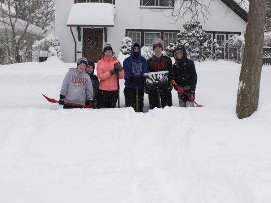 A group of shovelers Wednesday on Vermont Avenue in Binghamton.