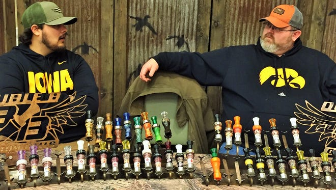 Zach Hornberg, left, and Chris Betts are shown manning a trade show booth that displays some of their Double B brand duck and goose call inventory.