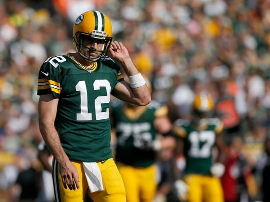 Green Bay Packers quarterback Aaron Rodgers (12) comes off the field after third down in the first quarter of the NFL Week 3 game between the Green Bay Packers and the Cincinnati Bengals at Lambeau Field in Green Bay on on Sunday, Sept. 24, 2017.
