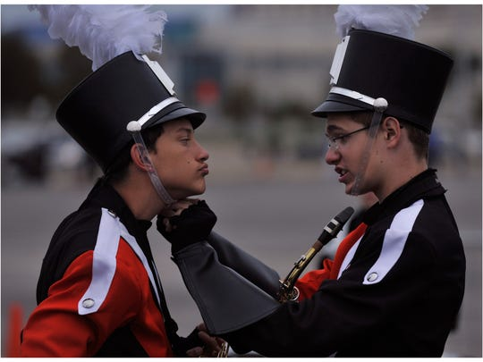 Koy Bell holds his chin out as fellow freshman Kaden Dycus adjusts the strap on his hat. The two play alto saxophone for the Rotan High School Yellowhammer Band and readied themselves to compete in the Class 1A UIL State Marching Band Championships in 2017.