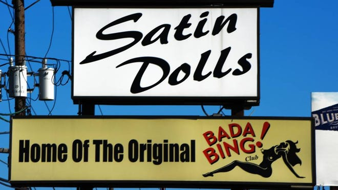 Signs atop the Satin Dolls club in Lodi.