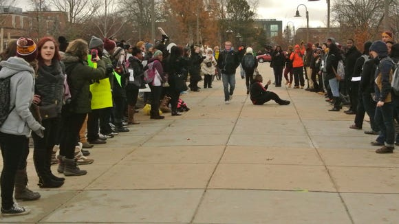 Over 120 students protested a Missouri's grand jury decision to not indict Officer Darren Wilson for killing Michael Brown on the campus of Central Michigan University on Tuesday, Nov. 25, 2014.