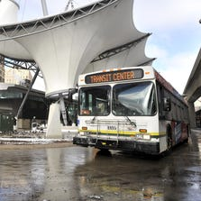 A DDOT bus makes the run around at the Rosa Parks Transit Center in Detroit in this Dec. 27, 2012 file photo.