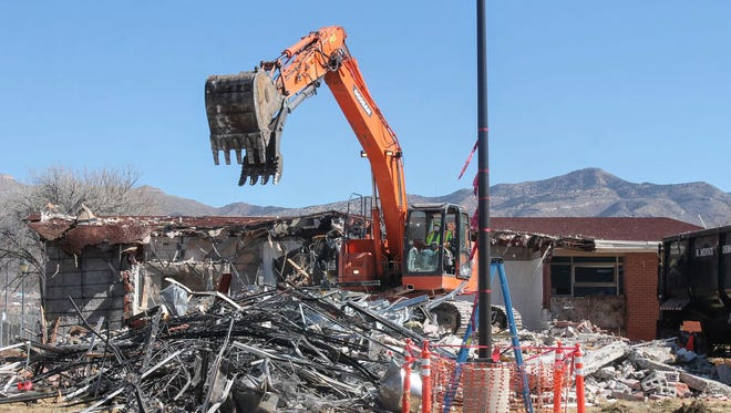 Construction crews demolished the San Andres administration building on the campus of the New Mexico School for the Blind and Visually Impaired early Monday morning.