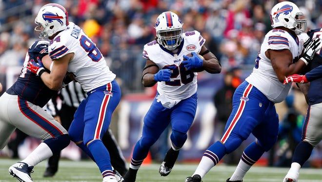 Buffalo Bills running back C.J. Spiller (28) runs the ball against the New England Patriots during the first half at Gillette Stadium.