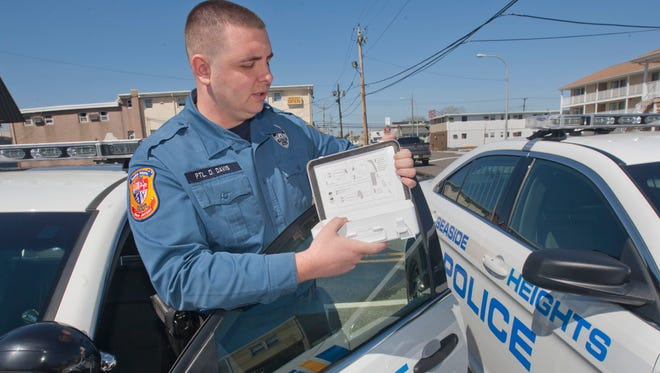 Seaside Heights Officer Daniel Davis  holds a Narcan kit, used to help revive victims of heroin overdoses.