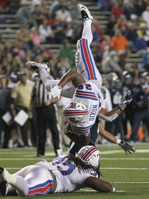 Louisiana Tech Bulldogs running back Kenneth Dixon (28) flips over a defender in last week's win over Rice.