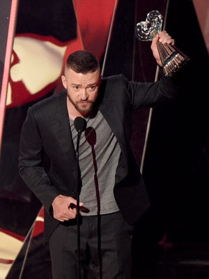 "Justin Timberlake accepts the award for song of the year for ""Can't Stop The Feeling!"" at the iHeartRadio Music Awards at the Forum on Sunday, March 5, 2017, in Inglewood, Calif. (Photo by Chris Pizzello/Invision/AP)"