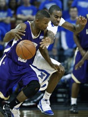 Memphis' Elliot Williams, right, battles  LeMoyne-Owen College's Taurean Moy, left, for a loose ball during first half action of their exhibition game at the FedEx Forum during the 2006-07 season.