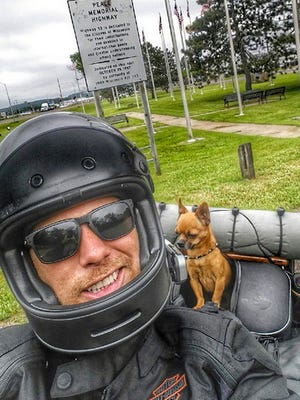 Adam Sandoval and Scooter riding through Wisconsin on their trek to raise money for children of service members who died on active duty. Sandoval will visit Vandervest Harley-Davidson in Peshtigo on Tuesday and Vandervest in Howard on Thursday.