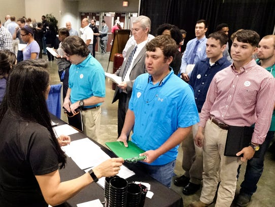Jobseekers line up to speed to a potential employer