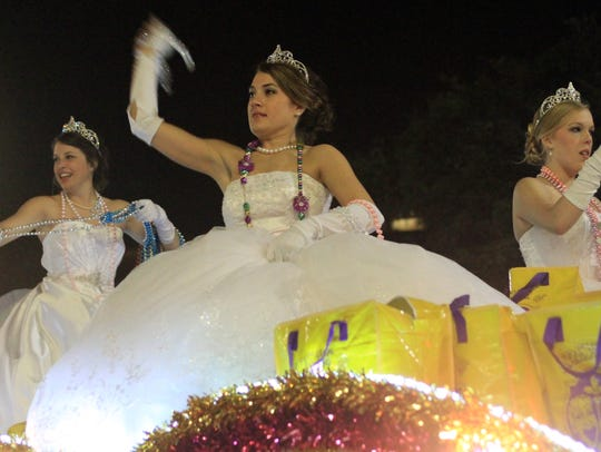 The 2012 Queen's Parade rolls through downtown Lafayette