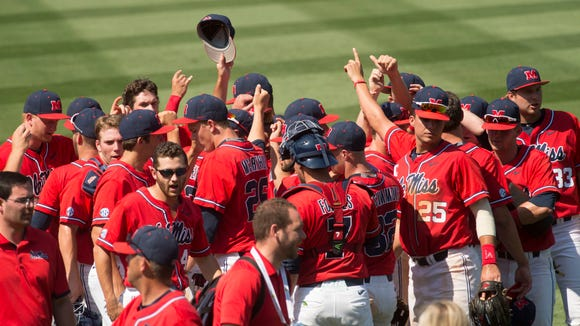 Mississippi players celebrate after defeating Georgia, 5-1, in the first round of the Southeastern Conference NCAA college baseball tournament in Hoover, Ala., Tuesday, May 24, 2016.
