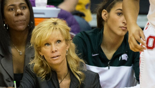 Michigan State Spartans head coach Suzy Merchant watches from the bench against the Ohio State Buckeyes at the Schottenstein Center.