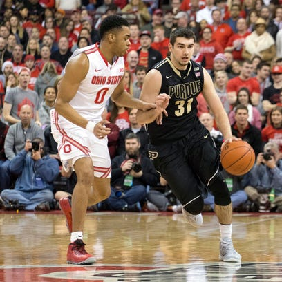 Ohio State Buckeyes guard D'Angelo Russell (0) guards Purdue Boilermakers guard Dakota Mathias (31) as he dribbles down the court during first half at Value City Arena.