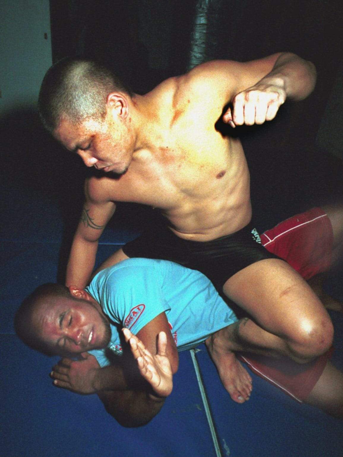 Ted Vida, top, demonstrates a mount punch with sparing