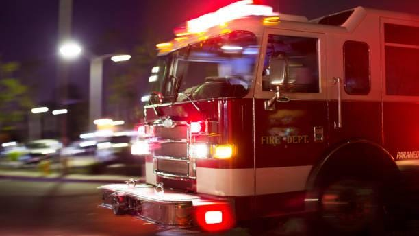 A firetruck races to the scene of an accident. First responders such as firefighters and paramedics say they are now faced with the additional stress of not knowing whether they are responding to a scene where there are COVID positive patients.